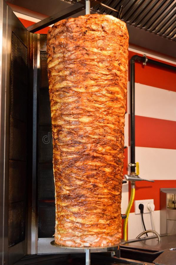 Rotary cooked Turkish chicken doner kebab. Delicious dishes of Turkish cuisine doner kebab. Rotary cooked stock photos
