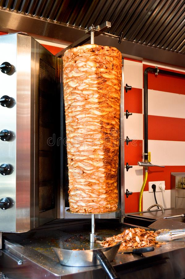 Rotary cooked Turkish chicken doner kebab. Delicious dishes of Turkish cuisine doner kebab. Rotary cooked stock images