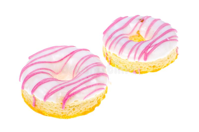 Delicious donut with white pink glaze on light background stock photos