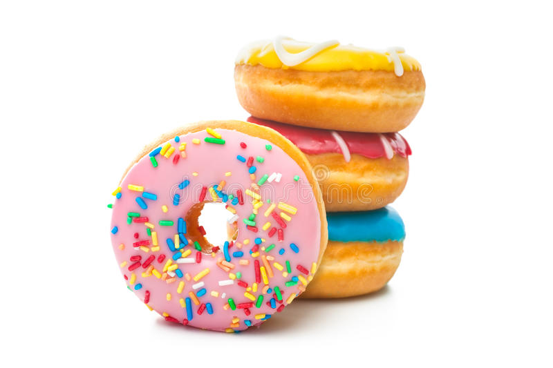 Delicious donuts with sprinkles. Group of glazed donuts, isolated on white background stock photography