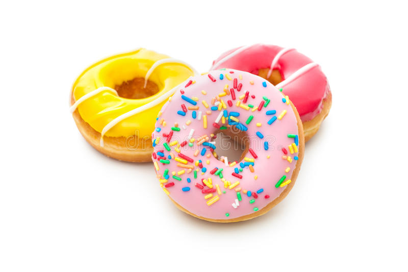 Delicious donuts with sprinkles. Group of glazed donuts, isolated on white background royalty free stock images