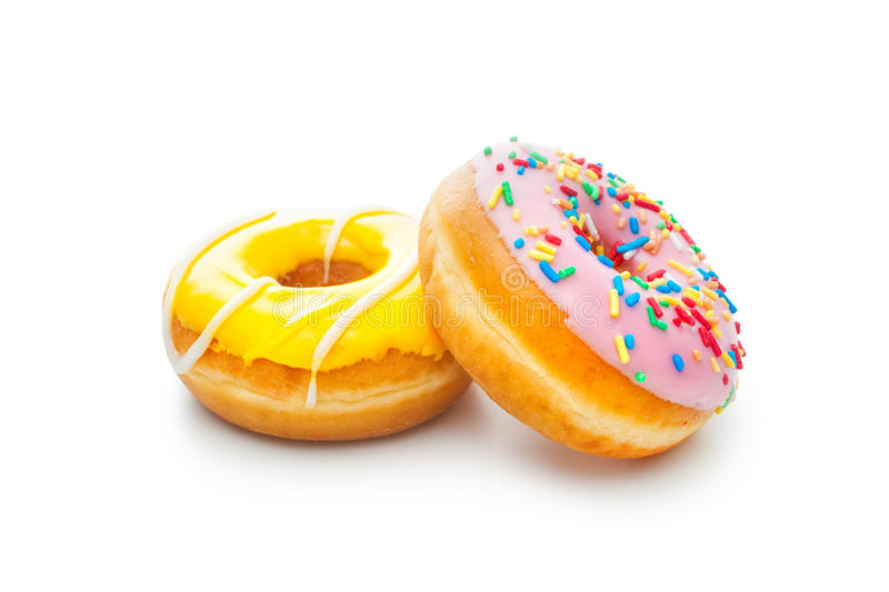 Delicious donuts with sprinkles. Two glazed donuts, isolated on white background stock photos