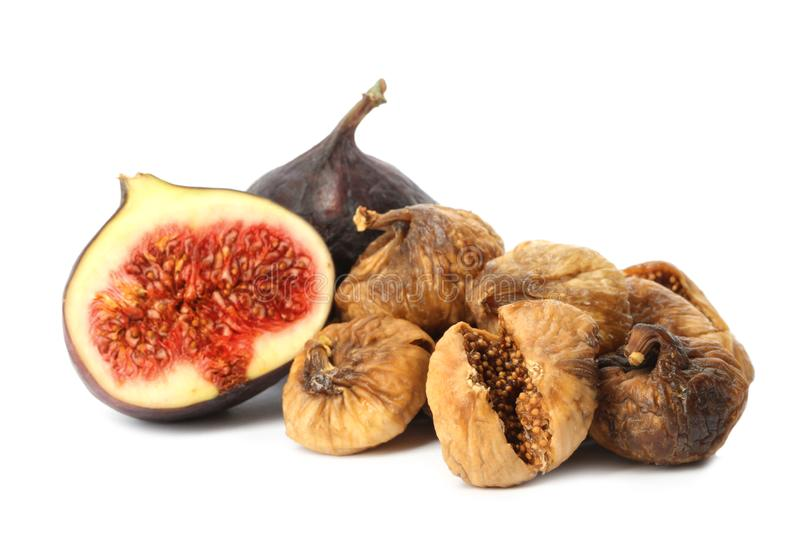 Delicious dried and fresh figs on white background royalty free stock photography