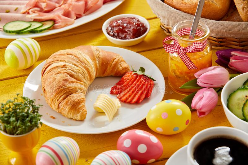 Delicious Easter breakfast on a decorated table stock image