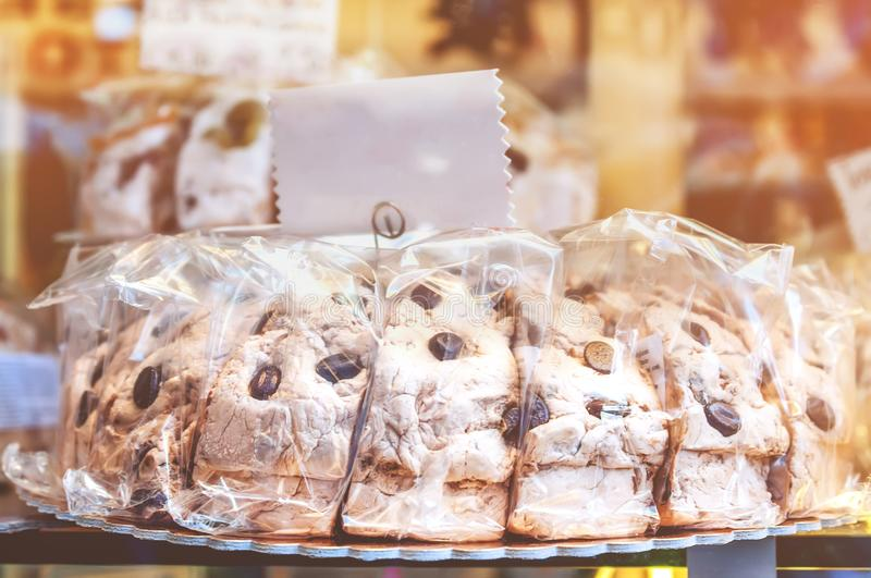 Delicious easy dessert from Mehring and marzipan with chocolate coffee beans in a transparent package holiday market. Soft focus. The horizontal frame stock photos