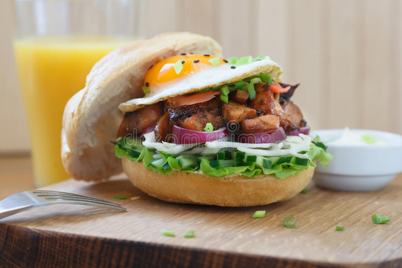 Delicious Egg Burger On Wooden Plate close view.  stock images