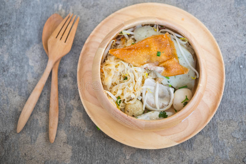Delicious egg noodle in bowl. Delicious egg noodle with pork fish ball and vegetable in bowl royalty free stock image