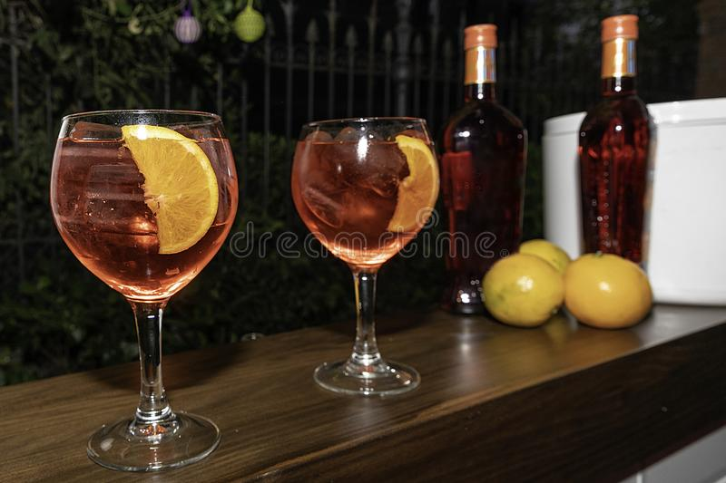 Delicious martinis with orange ready to be enjoyed royalty free stock photography