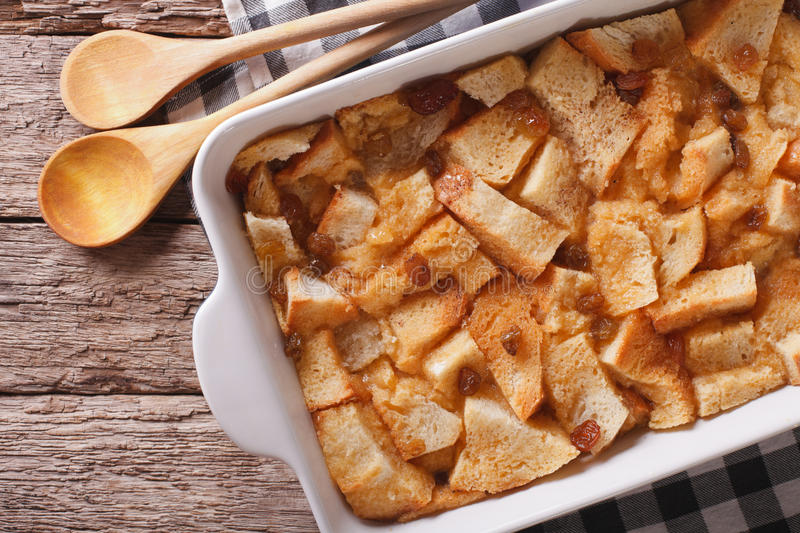 Delicious English bread pudding with raisins close up. Horizontal top view stock photography