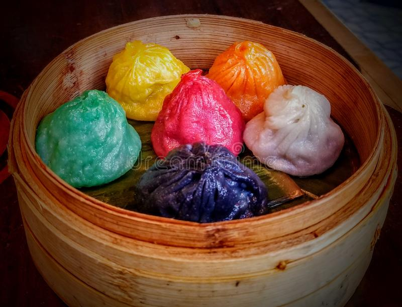 Delicious ethnic steamed dim sum dumplings  at Asian restaurant stock photo