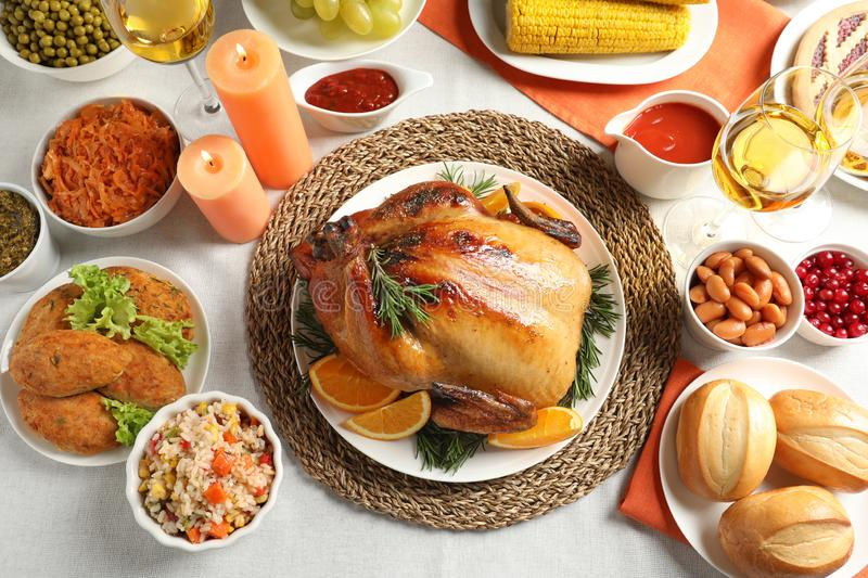 Delicious festive dinner with roasted turkey on table royalty free stock photo