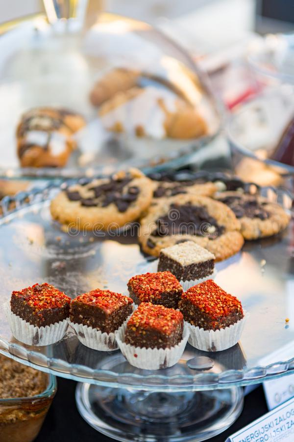 Delicious finger food deserts sold at outdoor market place. stock photos