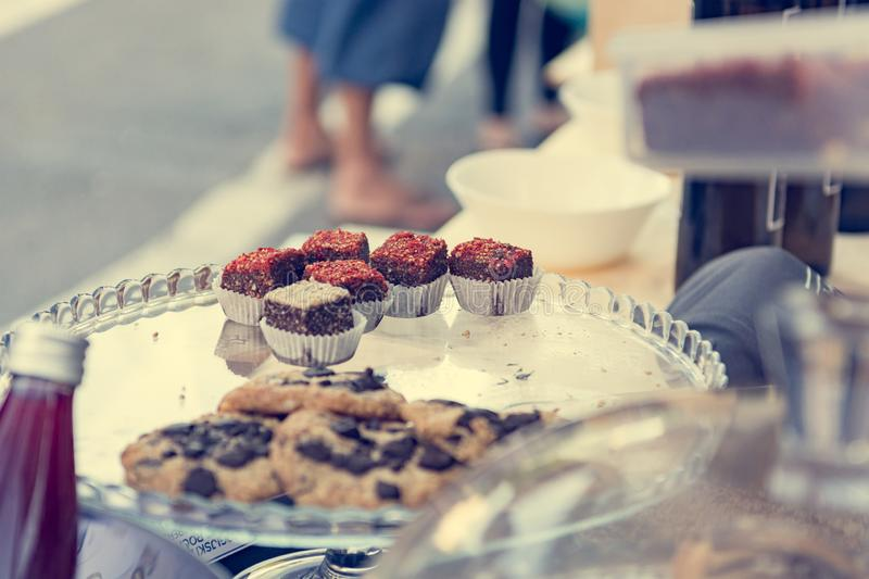 Delicious finger food deserts sold at outdoor market place. royalty free stock images