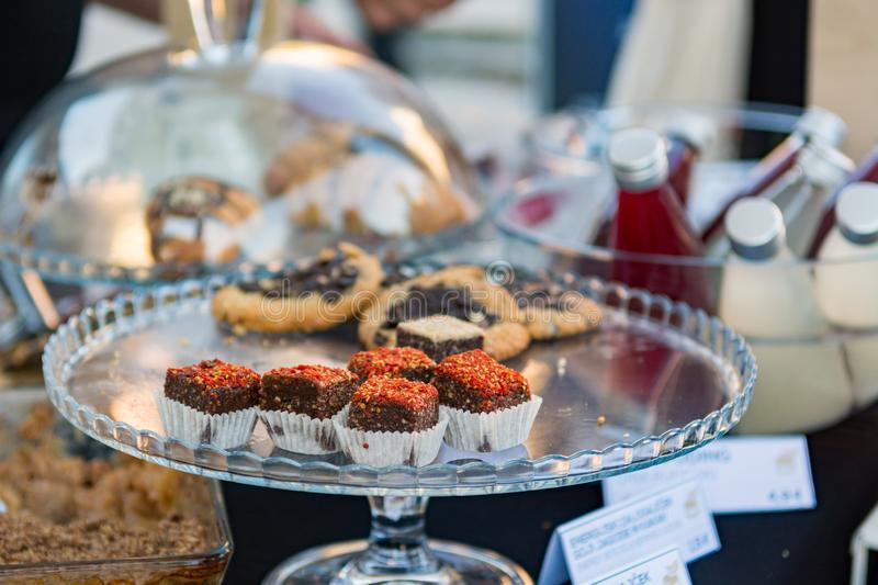 Delicious finger food deserts sold at outdoor market place. stock photography