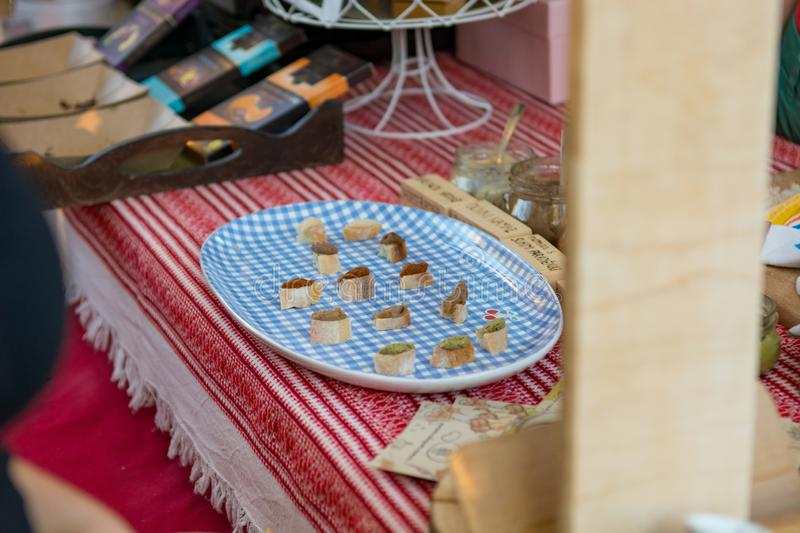 Delicious finger food deserts sold at outdoor market place. royalty free stock photo
