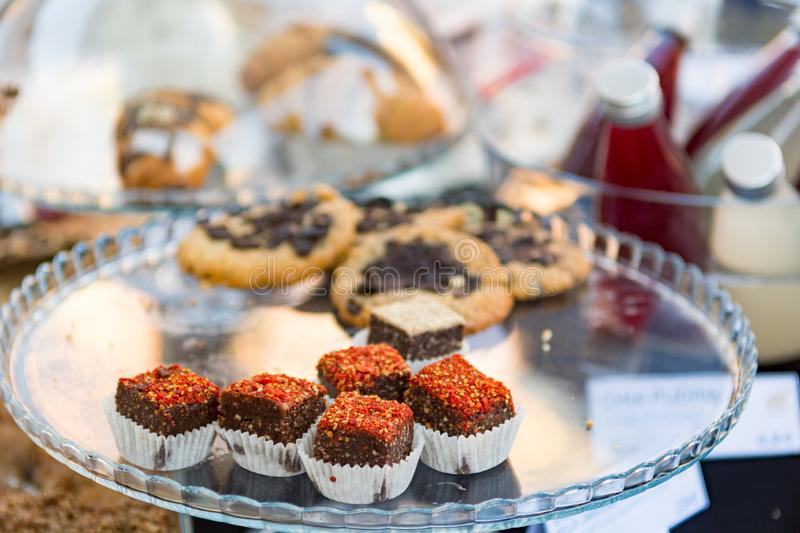 Delicious finger food deserts sold at outdoor market place. stock photo