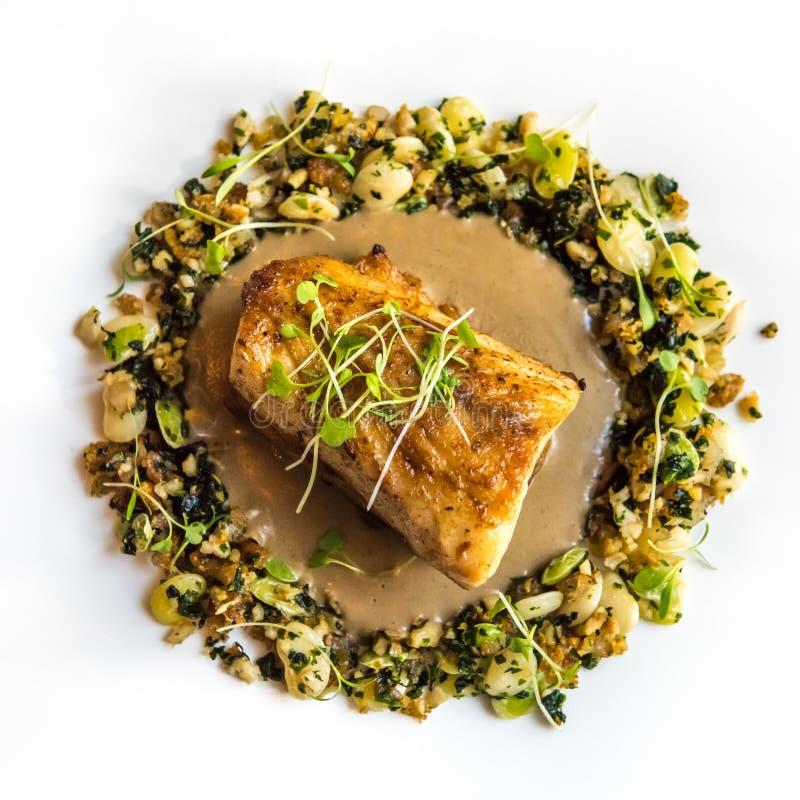 Delicious fish dish at gourmet restaurant.  stock image