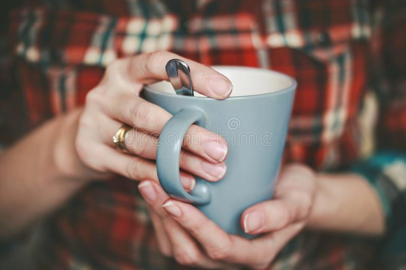 Delicious fragrant tea in the cup in women`s stock photo