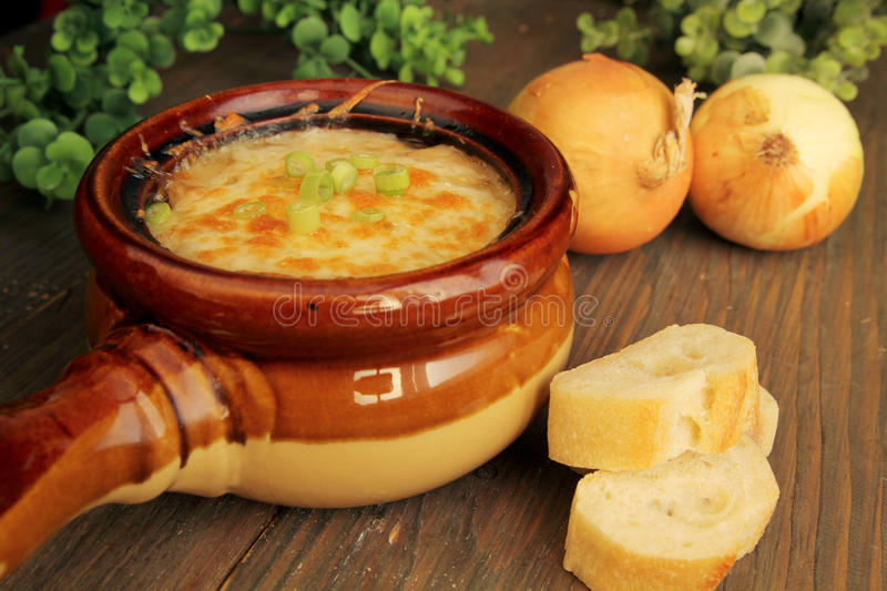 French onion soup. Delicious french onion french soup in a ceramic bowl royalty free stock photo