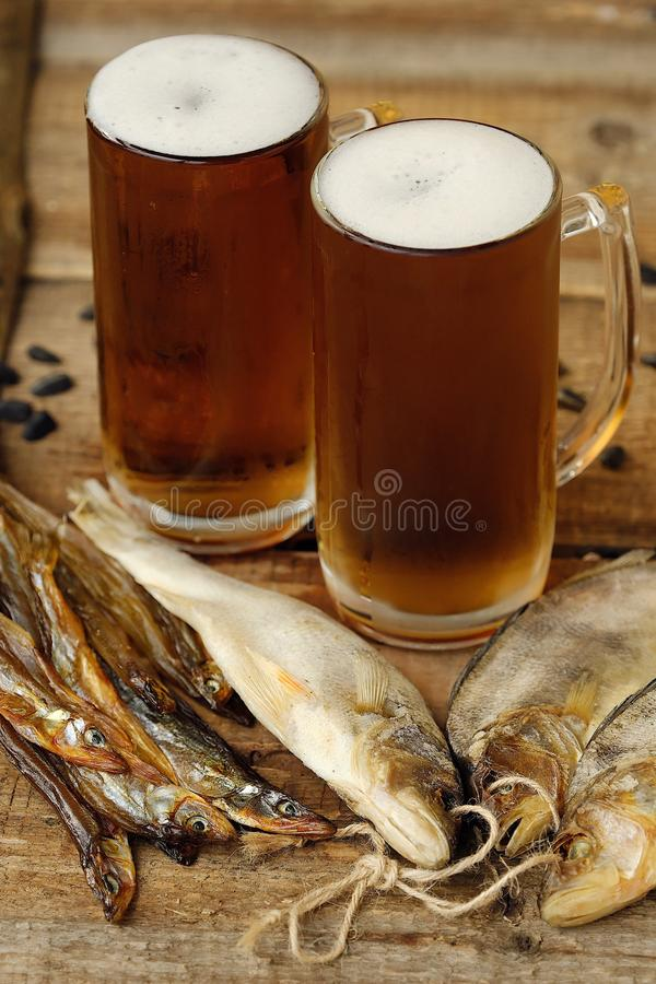 Delicious fresh beer and salted fish stock photo