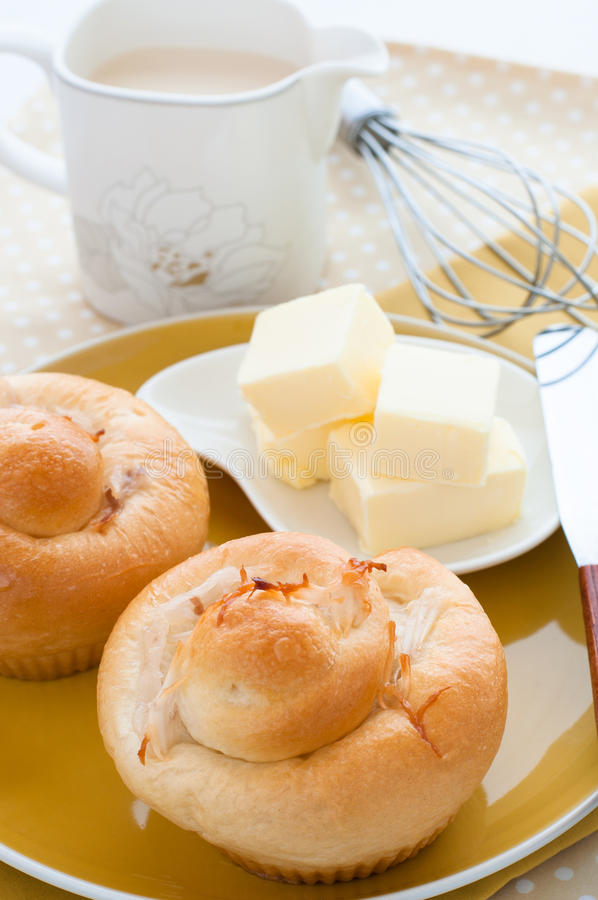 Delicious fresh coconut bun with butter. stock photo