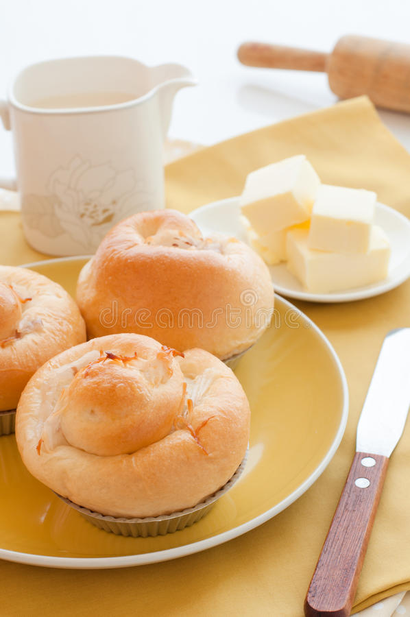 Delicious fresh coconut bun with butter. royalty free stock photos