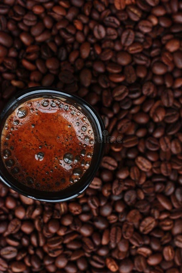 Delicious fresh coffee in a black mug stock photos