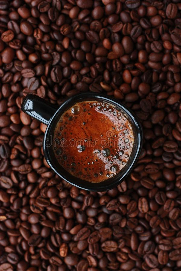 Delicious fresh coffee in a black mug stock image
