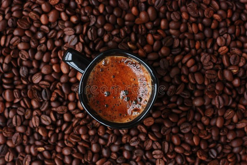 Delicious fresh coffee in a black mug stock photo
