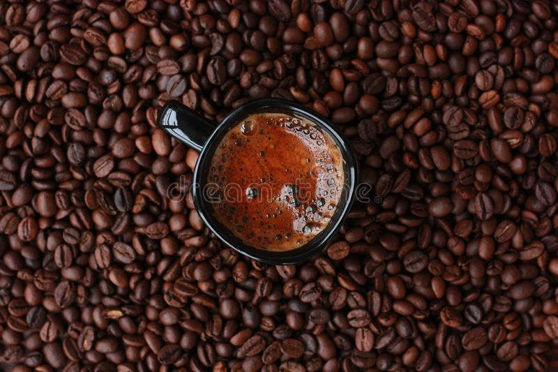 Delicious fresh coffee in a black mug royalty free stock photo