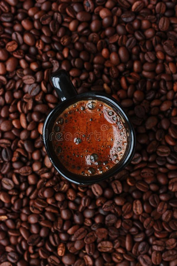 Delicious fresh coffee in a black mug royalty free stock photos
