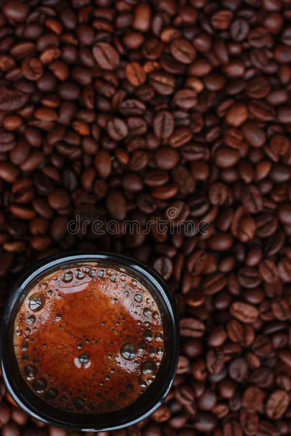 Delicious fresh coffee in a black mug royalty free stock image
