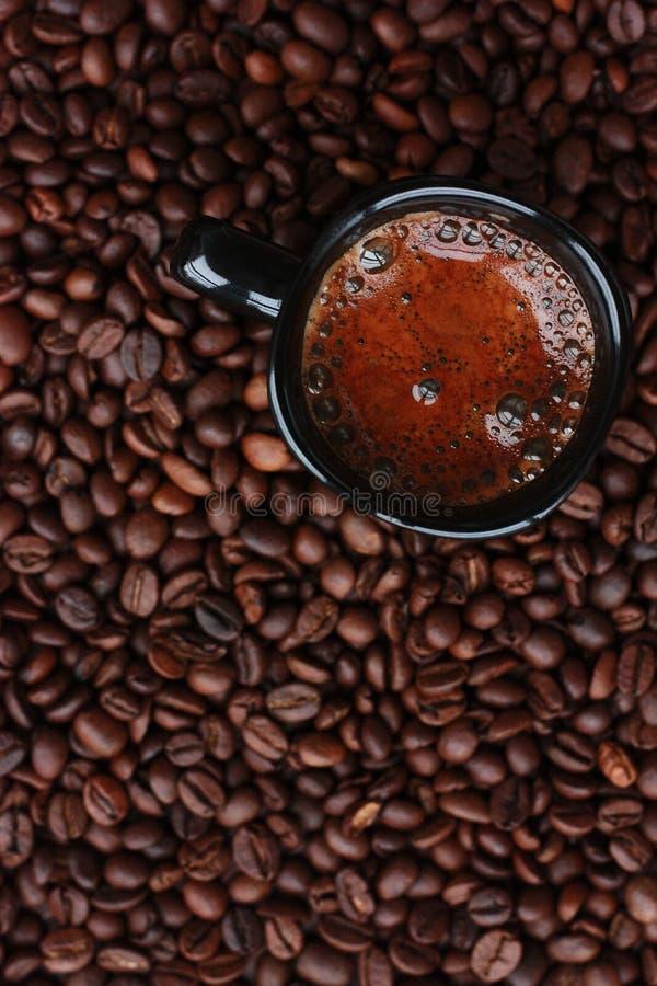 Delicious fresh coffee in a black mug stock photo