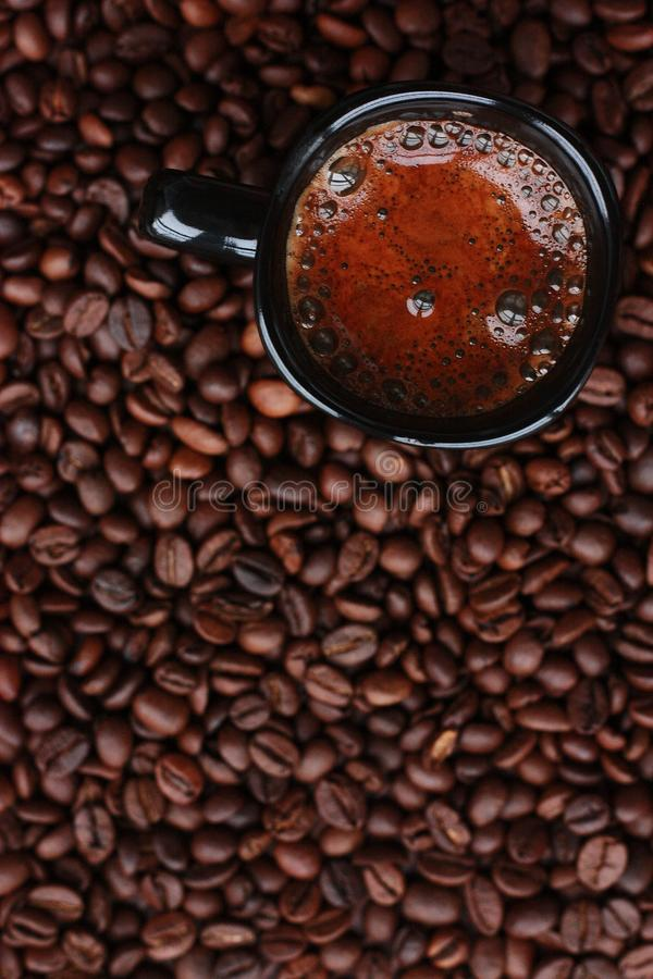 Delicious fresh coffee in a black mug stock images