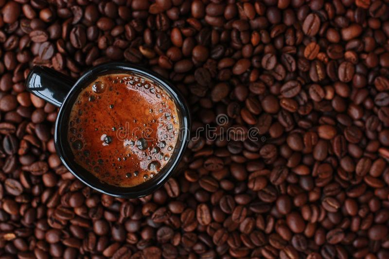 Delicious fresh coffee in a black mug stock photography