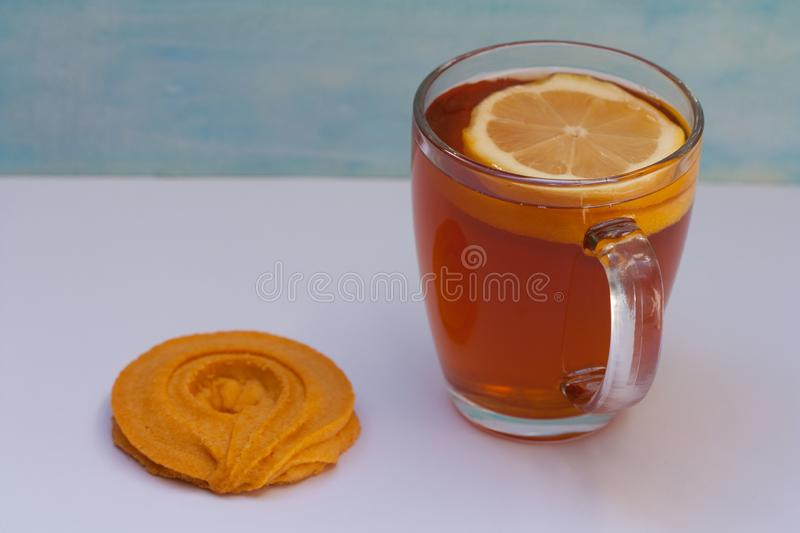 Delicious fresh cookie and tea with a lemon. Relax time. royalty free stock photo
