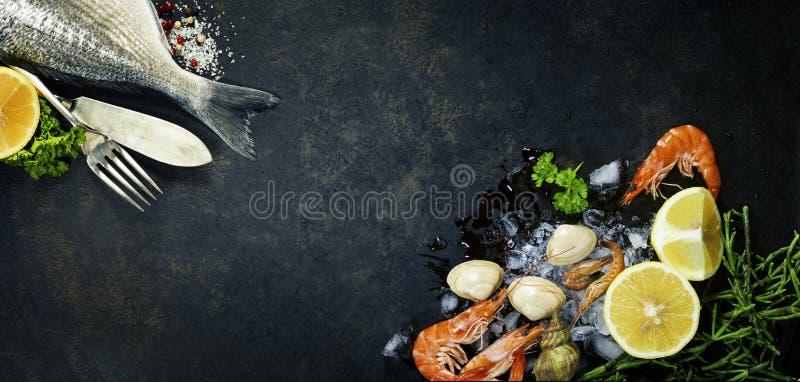 Delicious fresh fish. On dark vintage background stock photos