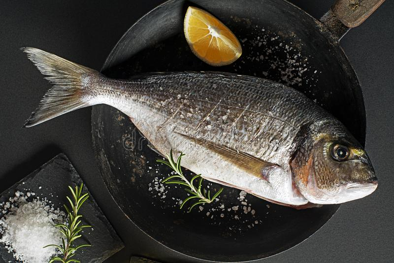 Fresh gilthead Fish prepare for cooking royalty free stock images