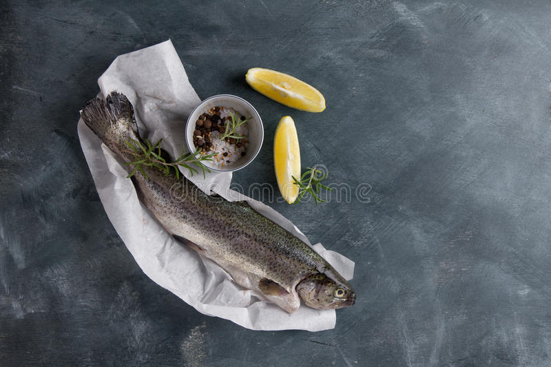 Delicious fresh fish trout. On vintage background for healthy food, diet or cooking concept, selective focus royalty free stock photo