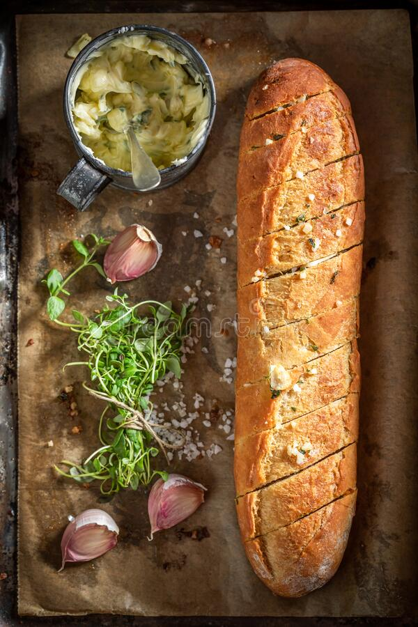 Delicious and fresh garlic bread with thyme and salt stock photography