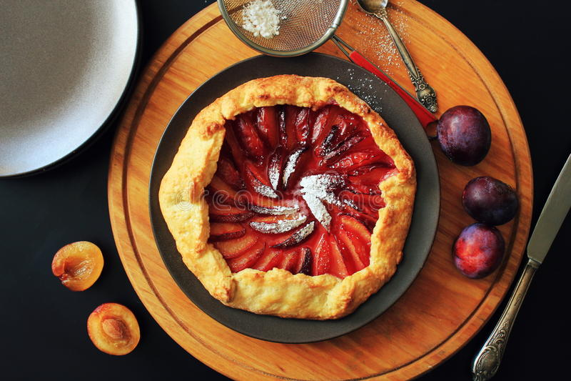 Delicious fresh homemade plum galette on table royalty free stock photo