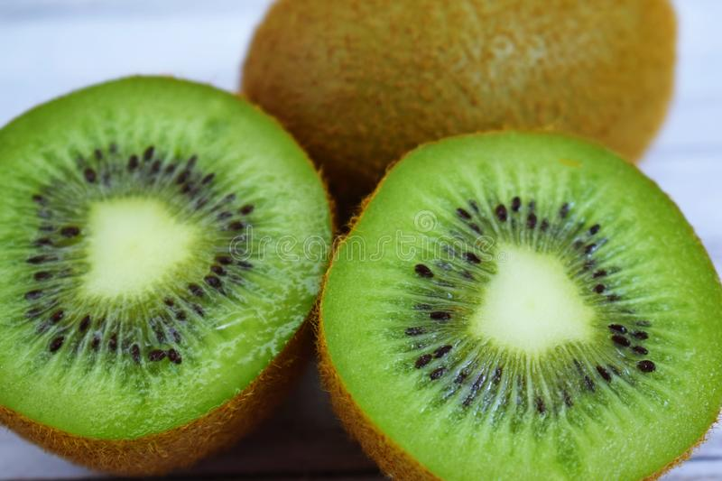 Delicious and fresh kiwis. Delicious and fresh kiwis on wooden background stock photos
