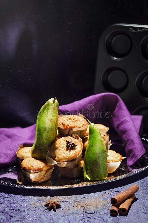 Delicious muffins with pear. Stilllife composition royalty free stock image