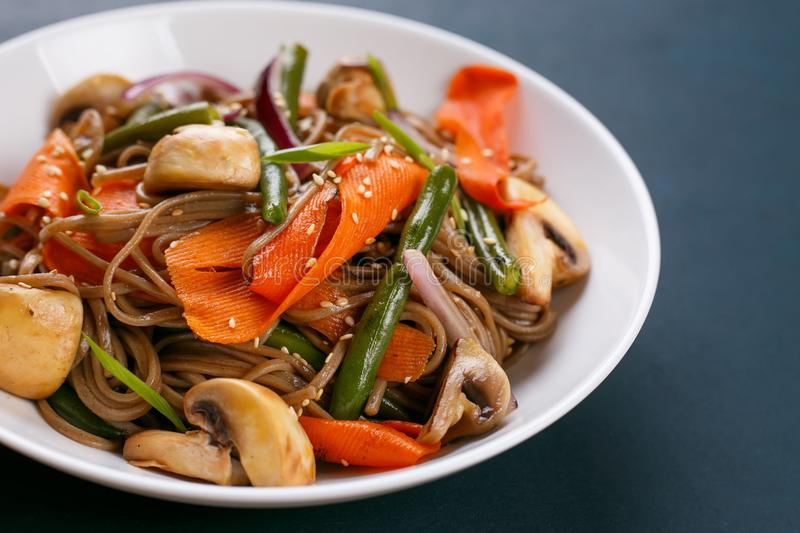 Delicious fresh pad thai noodles with mushrooms and vegetable sl. Ices. Thai food, vegetarian meals stock photos