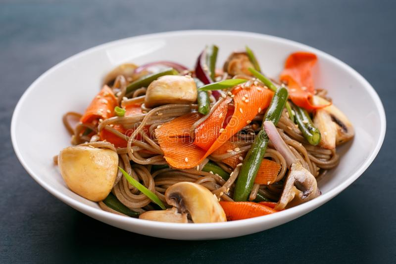 Delicious fresh pad thai noodles with mushrooms and vegetable sl. Ices. Thai food, vegetarian meals stock photo