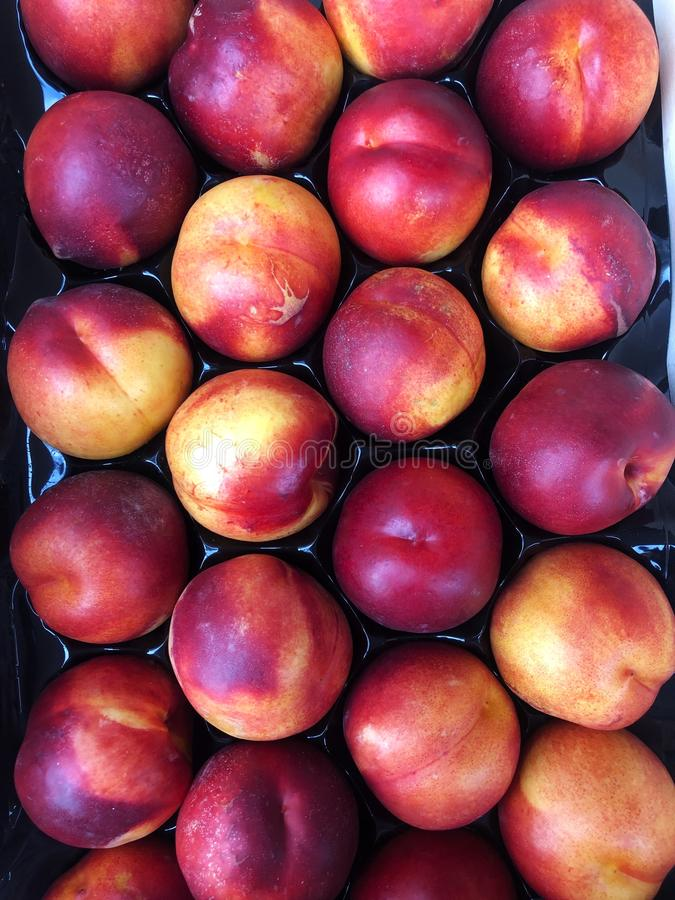 Delicious fresh peaches in summer on the market stock images