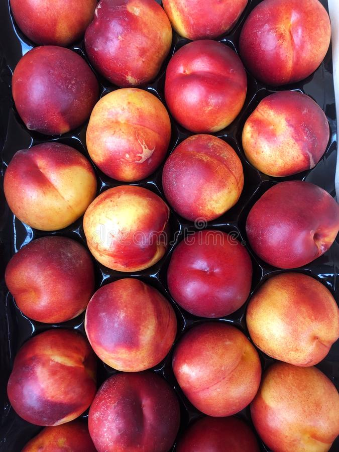 Delicious fresh peaches in summer on the market royalty free stock photo