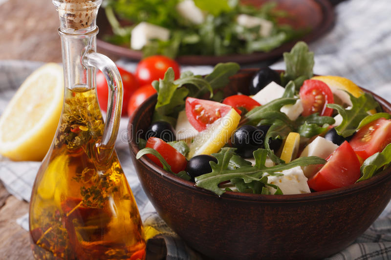 Delicious fresh salad with arugula, feta cheese and tomatoes stock images