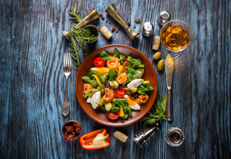 Delicious fresh seafood salad on the old wooden background stock photo
