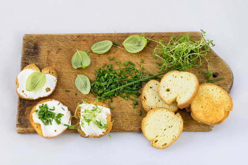 Delicious fresh spring vegetables and toasts for breakfast, whit royalty free stock photos